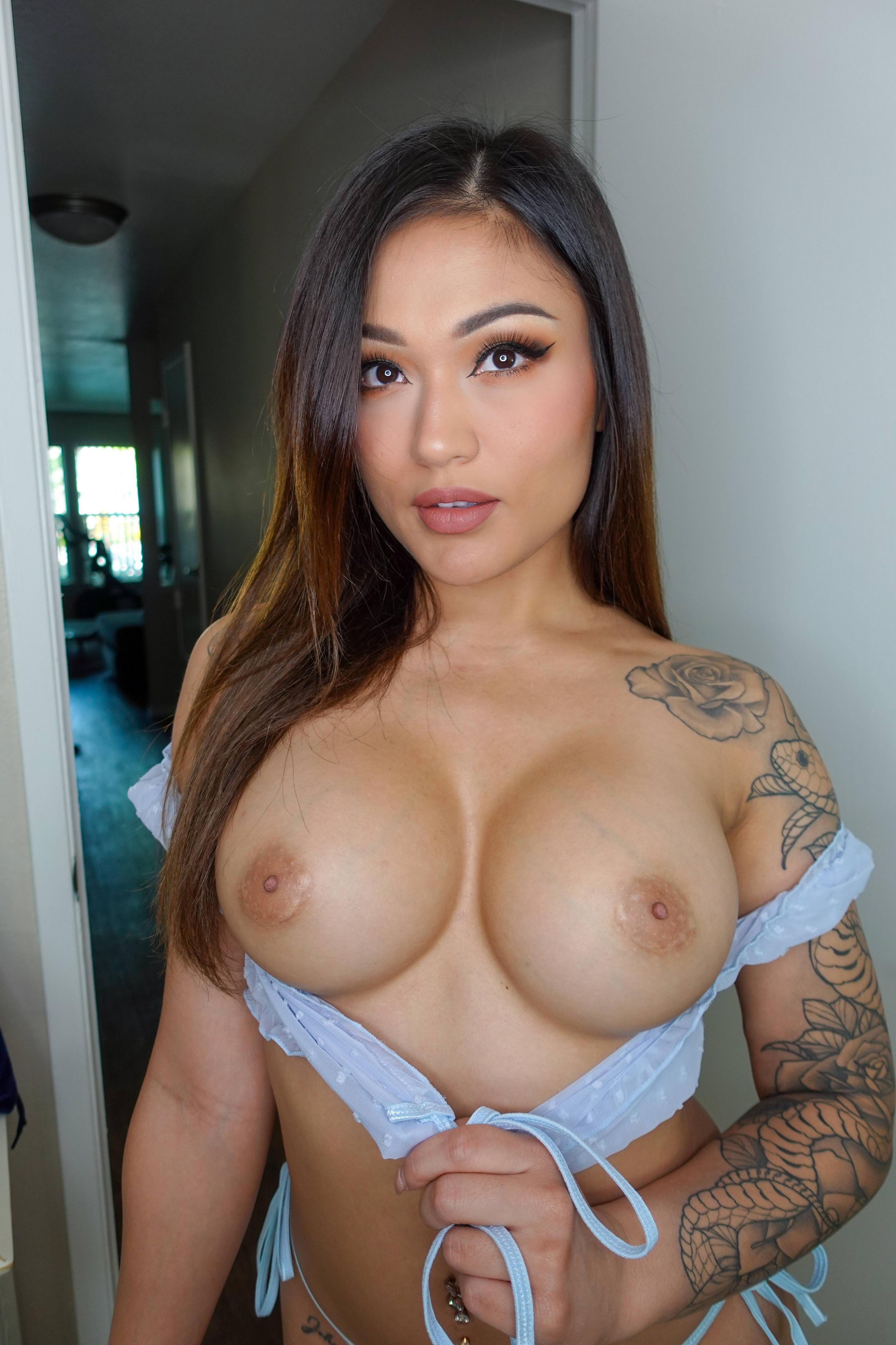 One of our naked asian pics called My tits are down here.